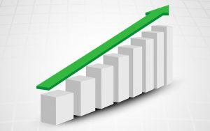 Gráfico em crescimento com colunas e uma seta verde