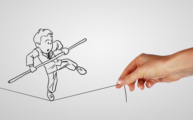 Desenho de um homem na corda bamba