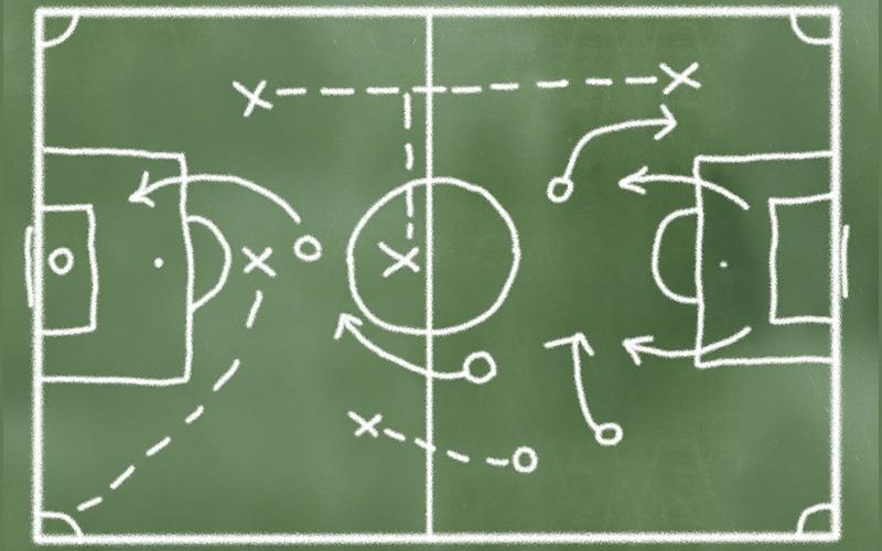 Planilha com campo de futebol desenhado