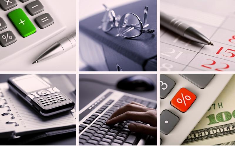 Imagem de calculadora, caneta, anotações